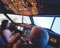 Führungsseminar im Flugsimulator - Pilot mit Teilnehmerin in Übung