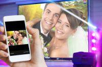 Interaktive Hochzeitsfeier – die digitale Selfiewall zeigt Handyfotos der Feier auf der Beamerleinwand live an