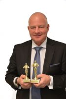 Roman Anlanger mit den zwei XING Awards