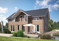 Die Fassade als prägendes Element eines Hauses: modern mit Klinkern in Szene gesetzt beim Living 166 von Hanlo Haus.