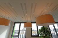 Thermoaktive Decke mit integrierten Akustikabsorbern/Foto:Innogration GmbH