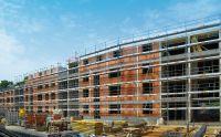 Unipor-Ziegelwände für eine platzsparende Bauweise: Der kleinere der beiden Gebäudeblöcke umfasst 33 Wohnungen.