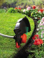 Die neuen Elektro-Sensen von Black & Decker verfügen über in die Schutzhaube integriertes Kantenschnittrad.