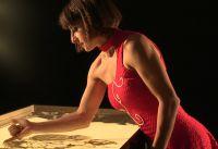 Berührende Sandmalerei Show bereiteten Künstler für Weihnachtsfeier der Firma