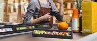 Warentrenner mit Digital Signage steigern den Umsatz am Point-of-Sale