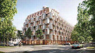 Die Fassade besticht durch imposante Formsprache und einen Dualismus von Metall und Glasfaserbeton. (© Bauwerk)