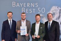 """Dr. Peter Burnickl (2.v.r.) und Thomas Lukas (2.v.l.) nehmen die Auszeichnung """"Bayerns Best 50"""" entgegen. Bild: Studio SX HEUSER"""