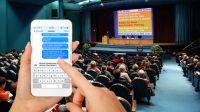 Aktives Mitarbeiter-Feedback mit der SMS-Chatwall live auf einem Beamer
