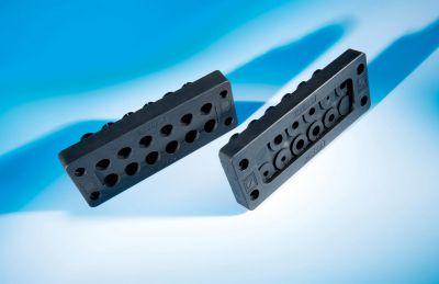 Die teilbaren Kabeldurchführungen KDL/C (vorn) und KDL/D (hinten) für den robusten Einsatz in extrem rauen Industrieumgebungen.