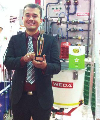 Die Nutrix+ wurde mit dem Innovationsstern im Bereich Schweinehaltung ausgezeichnet - Verkäufer Marco Haferkamp mit Auszeichnung.