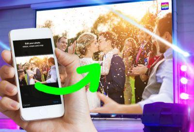 Handyfotos der Hochzeitsfeier live auf der Beamerleinwand mit der Selfiewall