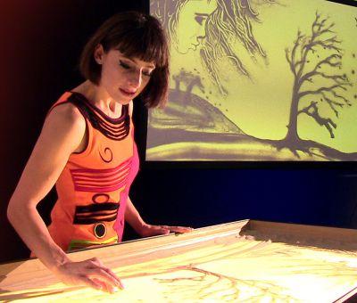 Showprogramm bei Abendveranstaltung mit Sandmalerei von Sabrina