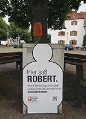 Kampagne #zurückimleben - Silhouette von Robert am St. Arnualer Markt