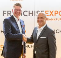 (v.l.n.r.) Torben Brodersen / Deutscher Franchiseverband und Tom Portesy / MFV Expositions Fotocredit: MFV / R. Unger